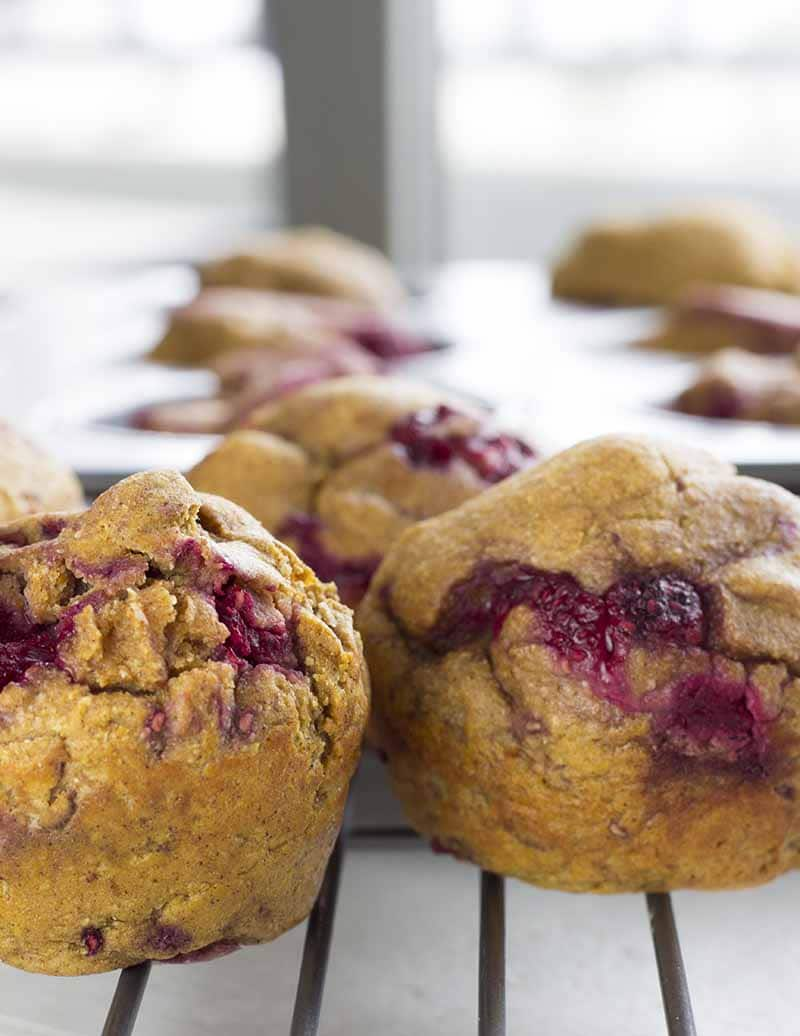Raspberry pumpkin muffins in a muffin pan