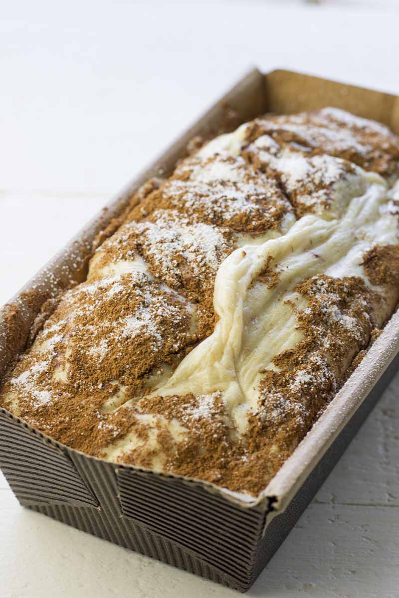 Cinnamon swirl cake in a paper loaf pan