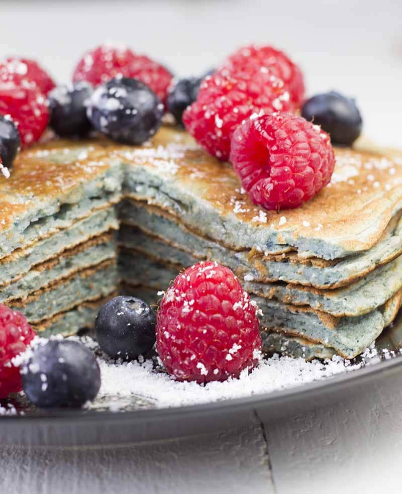 Closeup of a stack of protein pancakes with a bite cut out
