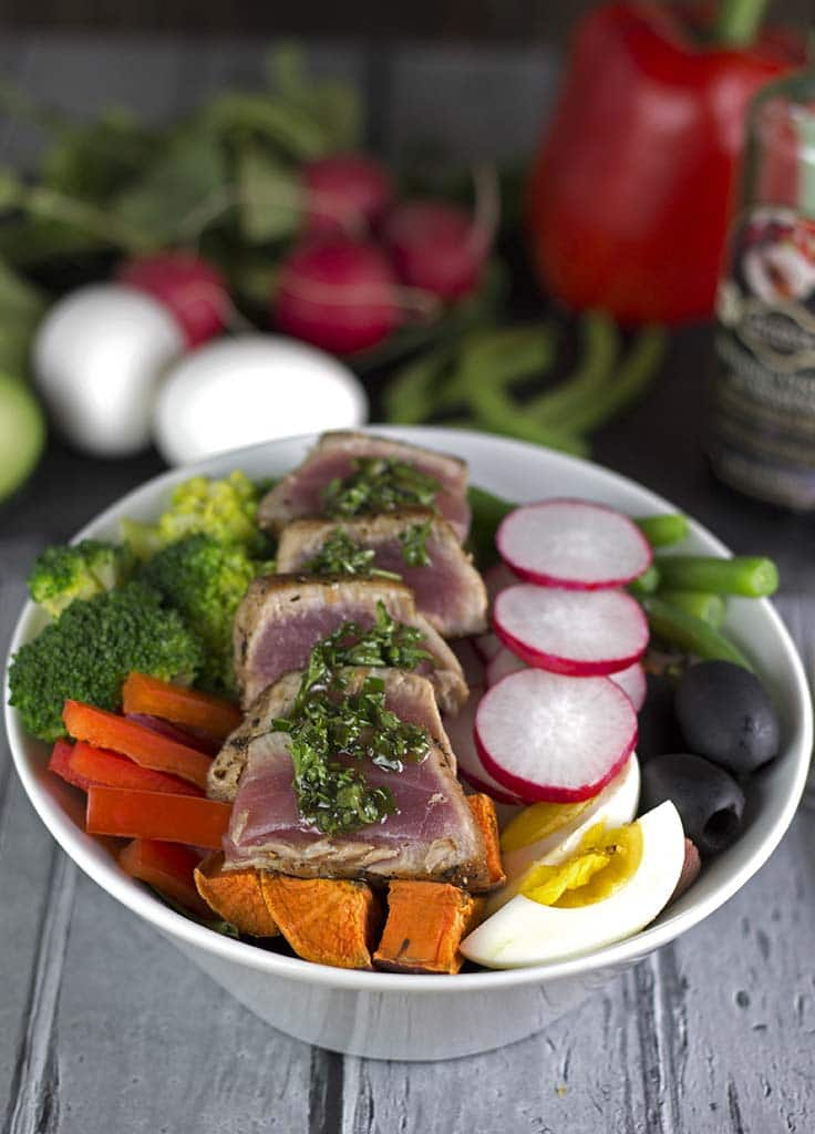 Rainbow Salad Nicoise - This is our take on the classic Salad Nicoise with Ahi Tuna, sweet potato, beans, eggs, a lot of fresh veggies and a parsley vinaigrette│TheFitBlog.com