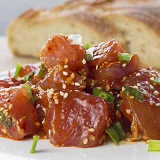 Ahi tuna poke on a plate with bread