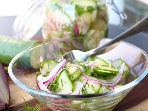Pickled cucumber salad in glass bowl