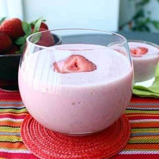 This cool and refreshing Strawberry Banana Protein Smoothie packs 25 grams of protein and is the perfect way to cool down with a healthy and delicious protein shake after a workout or day in the sun!