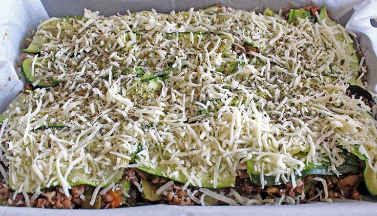 Fully assembled low-carb zucchini lasagna ready to put in oven