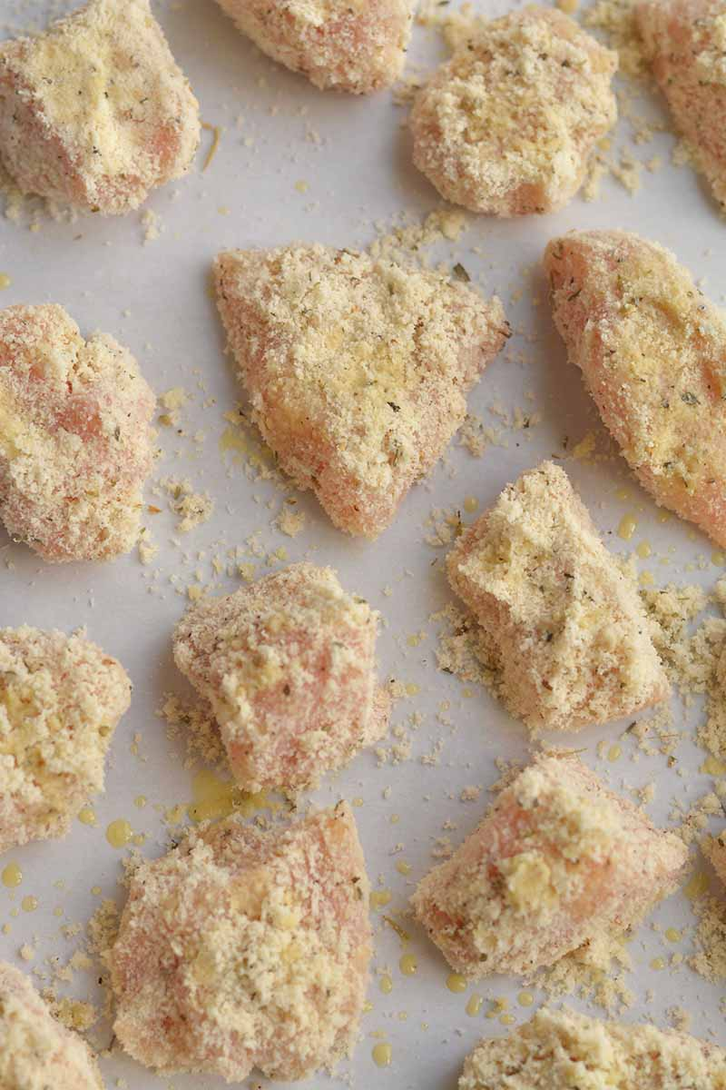 Raw chicken nuggets covered with almond flour