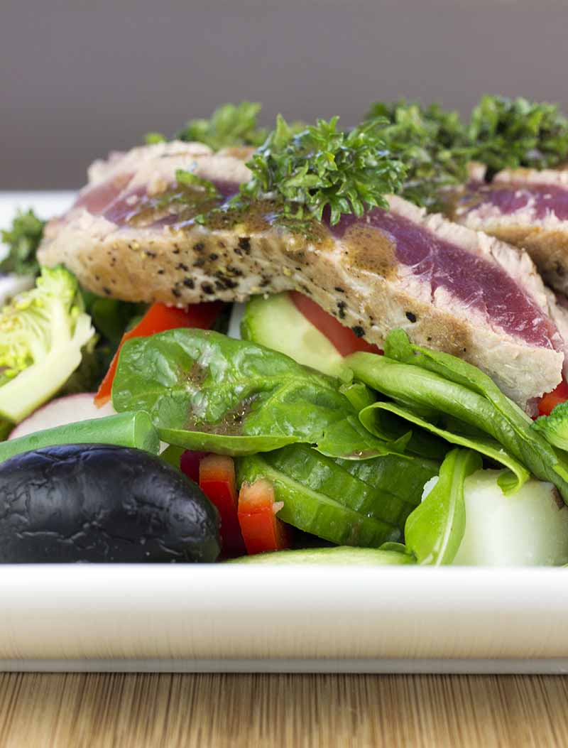 Tuna nicoise salad on a white plate