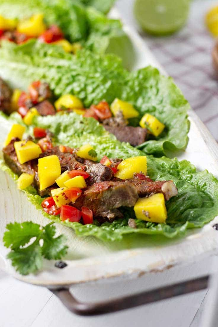 Three lettuce wraps with slow cooker beef and mango salsa