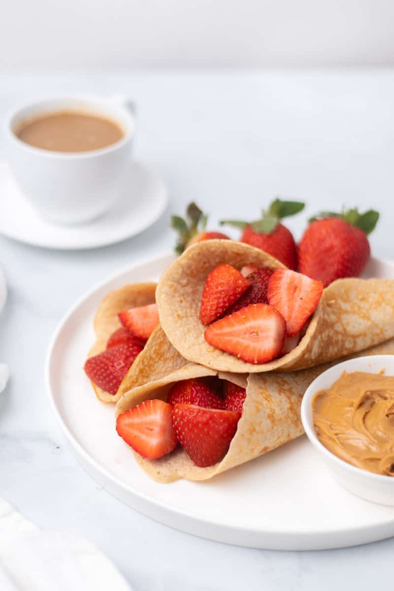 3 pancakes folded around berries