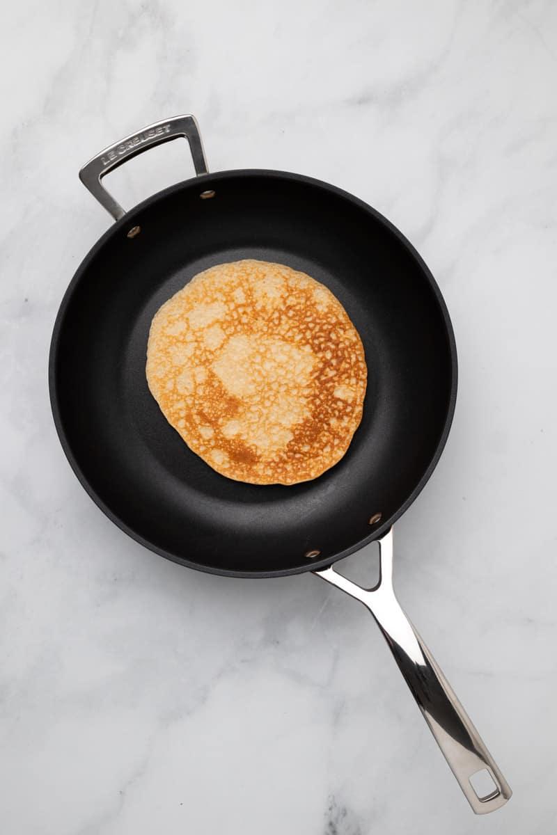 Golden brown pancake in a pan
