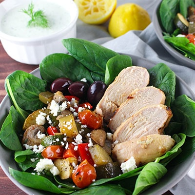 Tzatziki Chicken with Balsamic Roasted Veggies is an easy and healthy dinner you can have ready in less than 30 min. if you marinate the chicken in advance. High in protein and delicious flavors.
