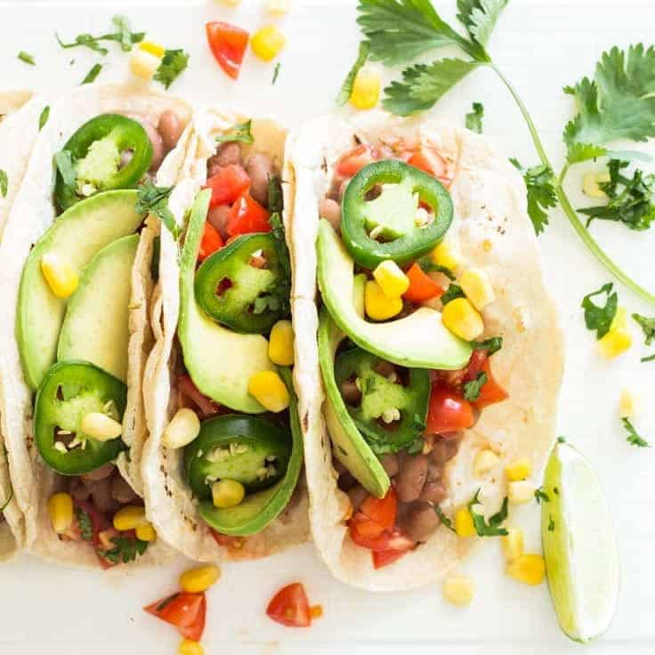 The beans, tomatoes, and avocados give these Vegan Pinto Bean Tacos a fantastic freshness and the sweet corn counteracts the spiciness of the chili, which feels amazing in the mouth and will make you want to eat a lot more tacos