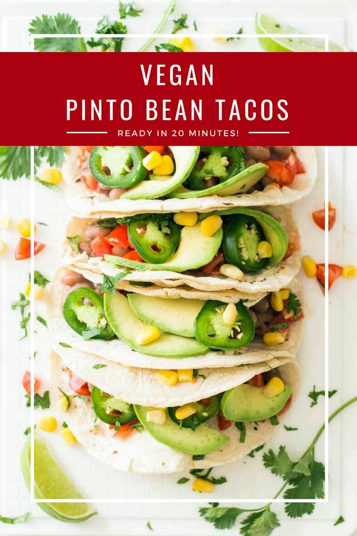 The beans, tomatoes, and avocados give these Vegan Pinto Bean Tacos a fantastic freshness, and the sweet corn counteracts the spiciness of the chili. Vegan tacos are the best! #vegan #tacos #pintobeans