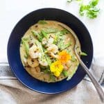 Thai Green Curry in a blue bowl with a spoon