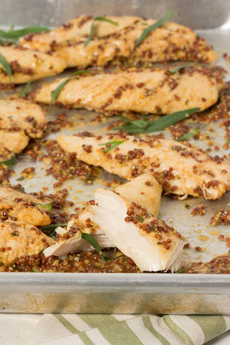 Mustard Baked Chicken Tenders in a baking dish, ready to be served