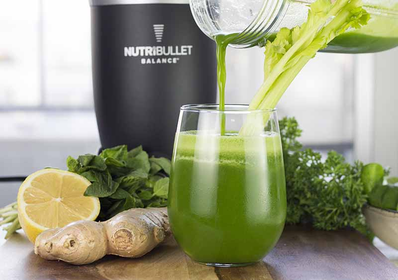 Green smoothie in front of the Nutribullet Balance