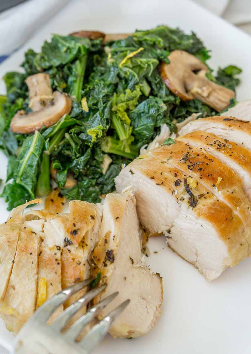 Healthy chicken and mushroom skillet with kale, plated and sliced