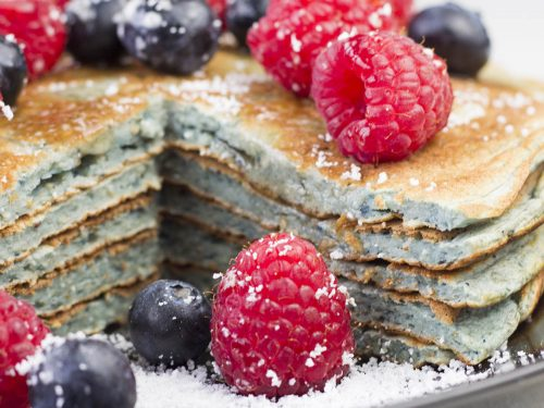 Stack of protein pancakes with berries