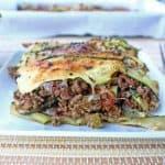 Zucchini lasagna on white plate