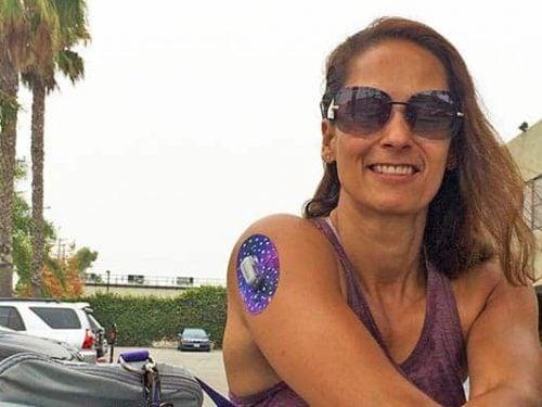 Christel with a Dexcom CGM patch on her arm