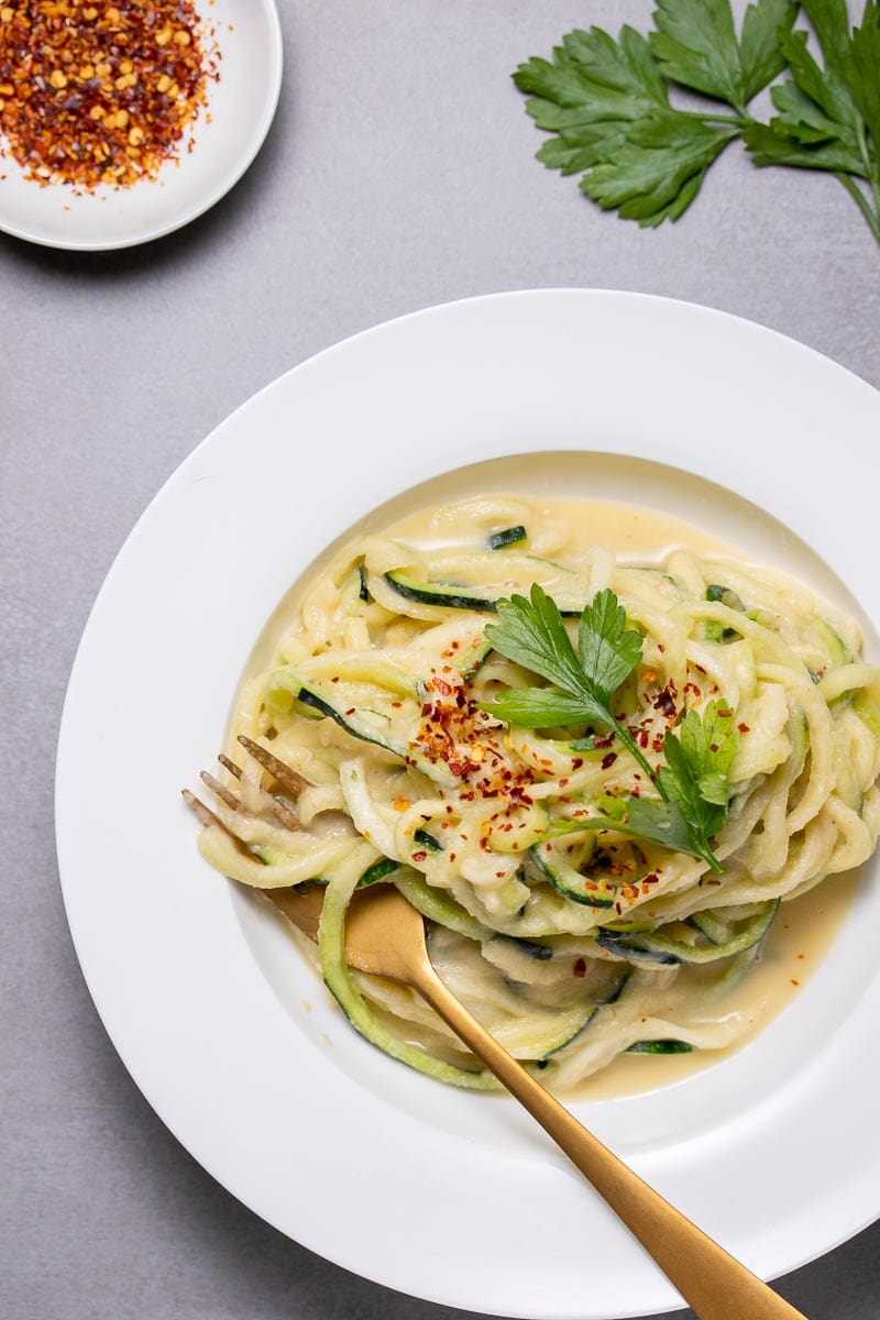 Vegan cauliflower Alfredo sauce on zucchini noodles