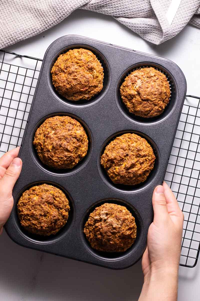 flat lay of carrot cake muffins out of the oven
