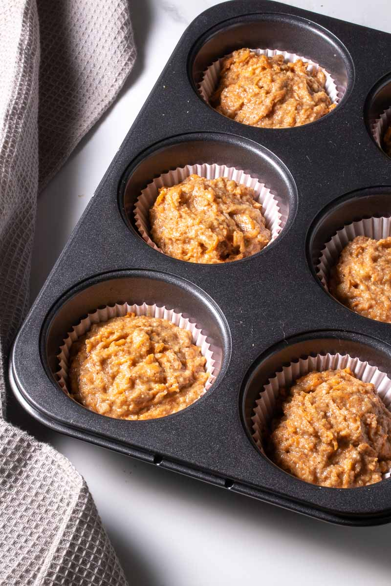 Raw muffins in the muffin tray
