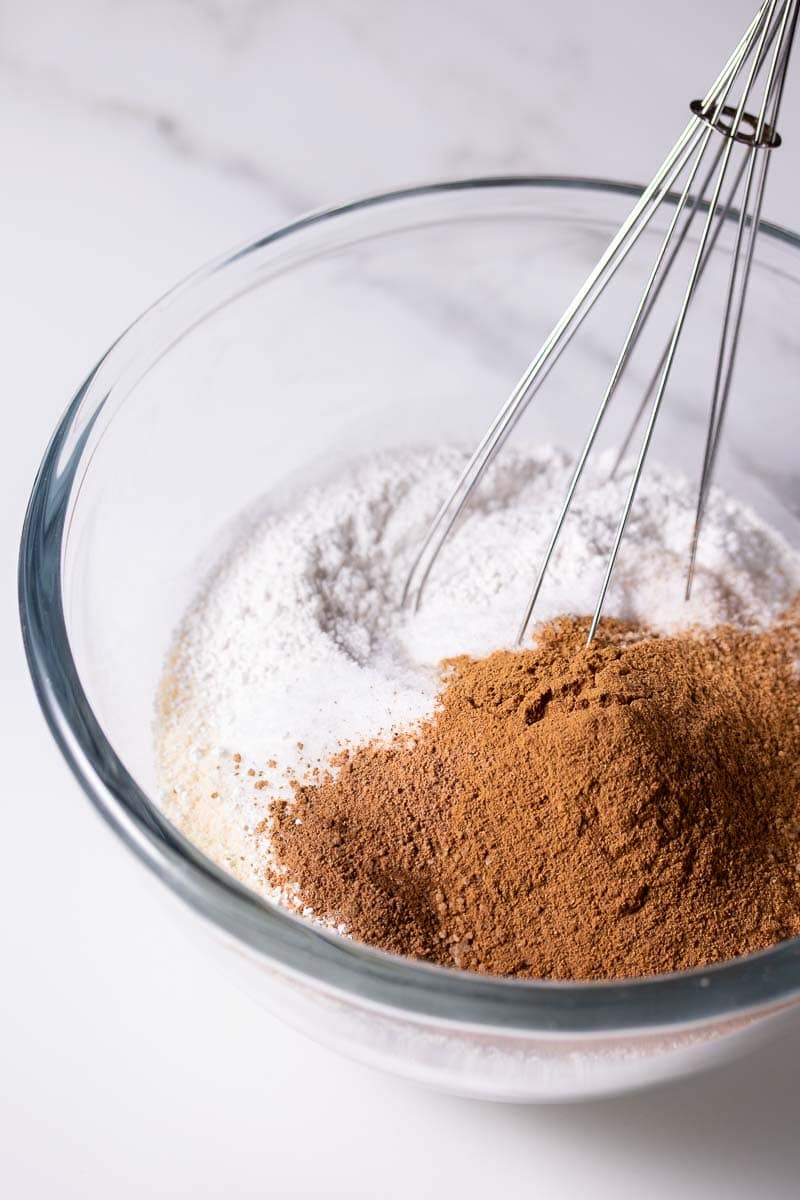Dry ingredients for the muffins in a bowl with a whisk