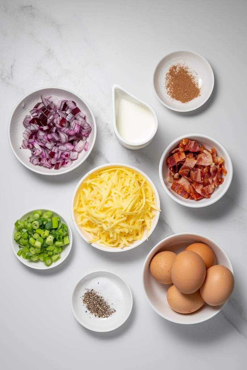 Ingredients for the keto quiche Lorraine in separate bowls, as seen from above