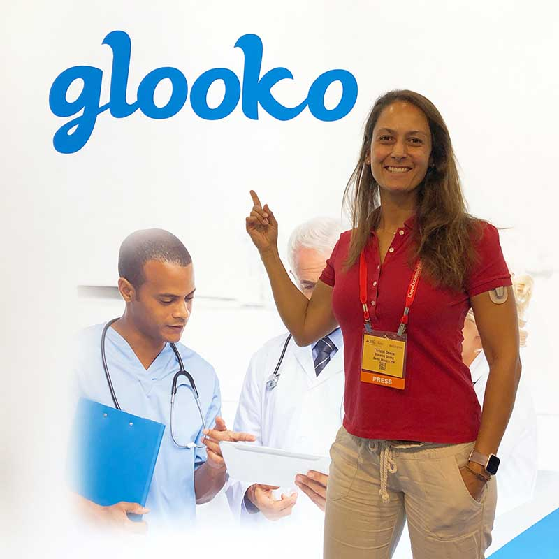 Christel in front of the Glooko both