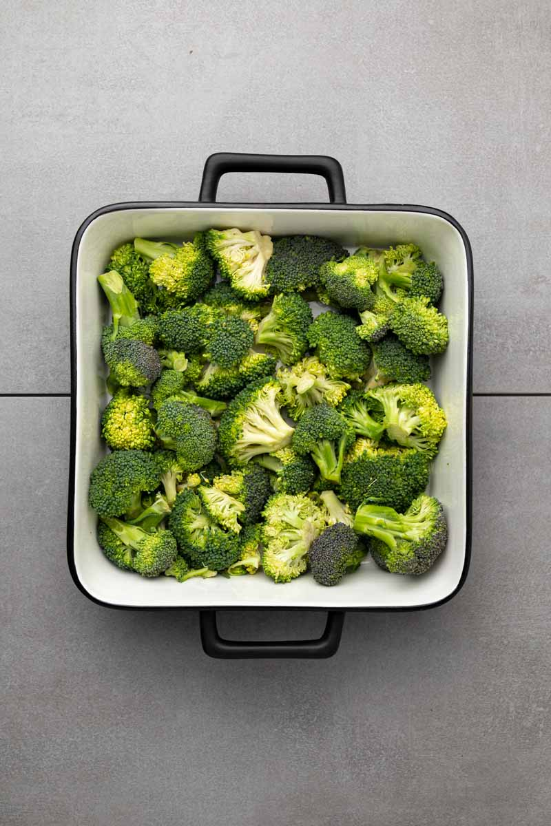 Broccoli florets in a square casserole dish