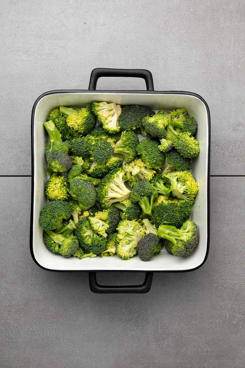 Broccoli florets in a square casserole dish