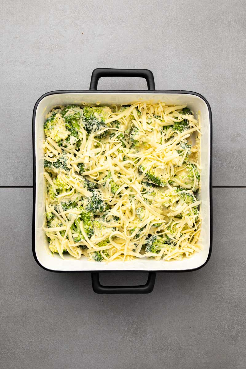 Casserole sprinkled with grated cheese before baking
