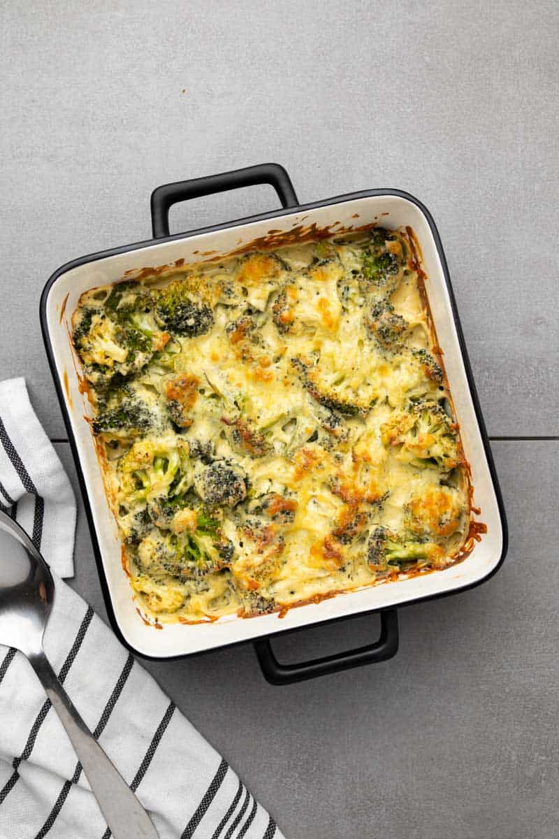 Keto broccoli casserole baked in a square baking dish, as seen from above