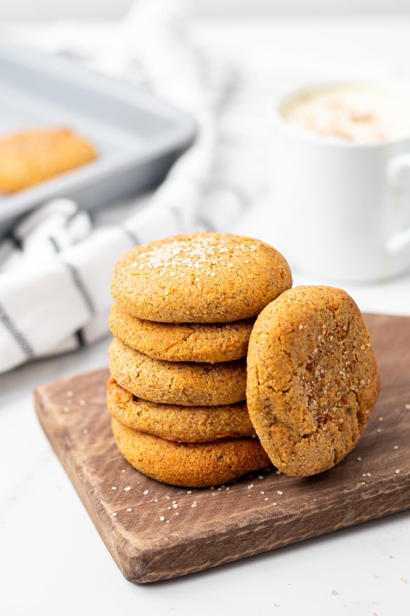 Stack of keto pumpkin cookies on wooden board