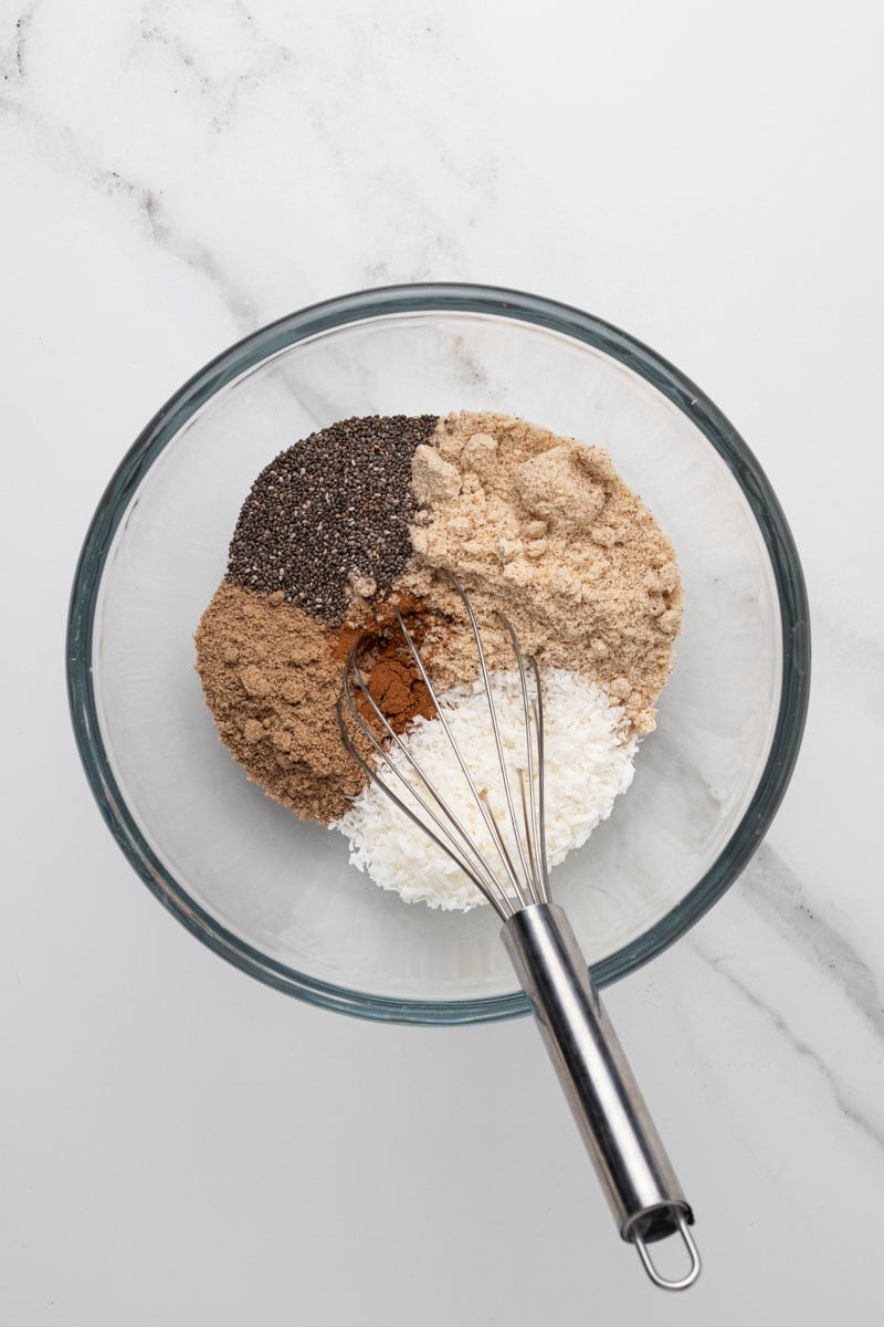 dry ingredients for the oatmeal in a bowl with a whisk