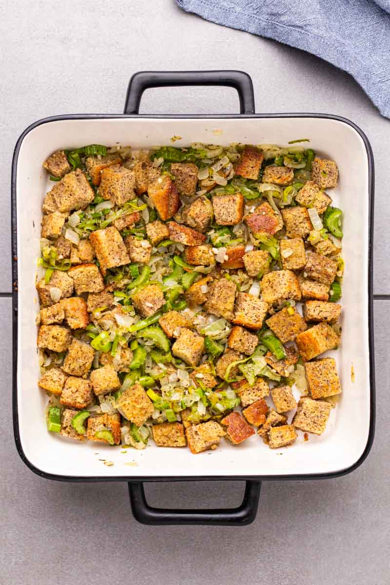 Vegetables added to the cornbread in a casserole dish