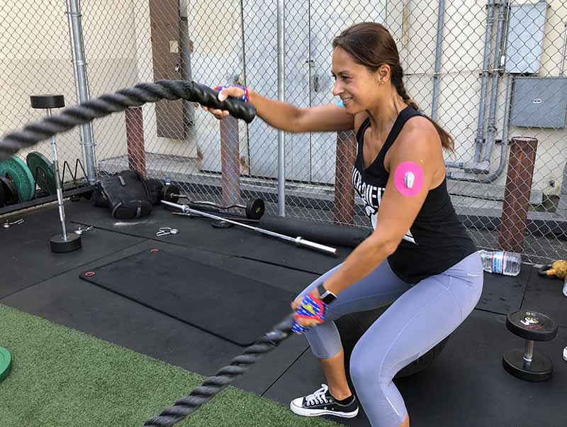 Christel exercising with her Skin Grip on the arm