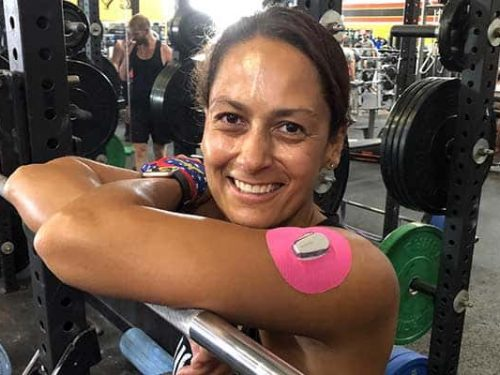 Christel at gym with Skin Grip on arm