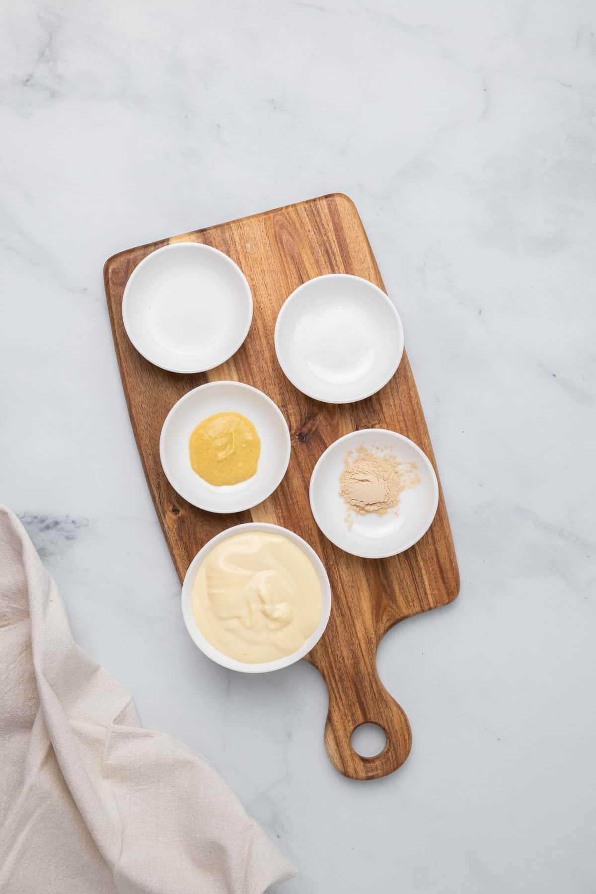 ingredients for the dressing on a wooden board