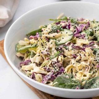 salad in white salad bowl close up