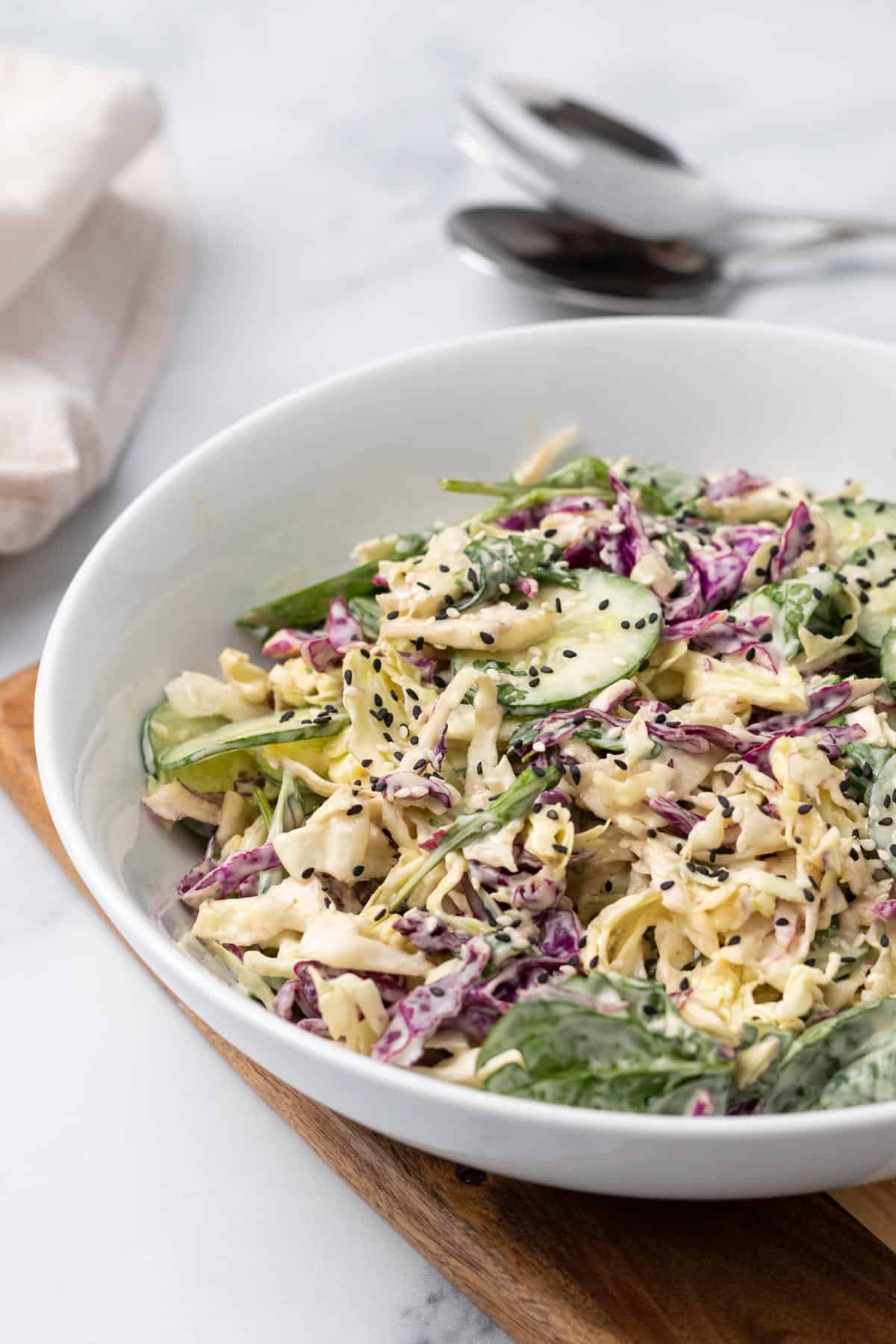 Purple cabbage salad in white bowl