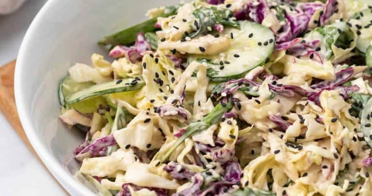 Purple cabbage salad in a white bowl