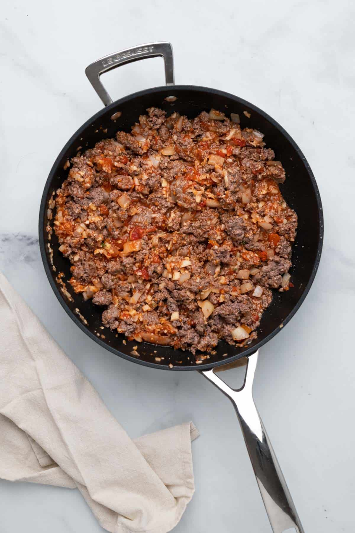 cooked mince, onion and tomato mixture in a pan