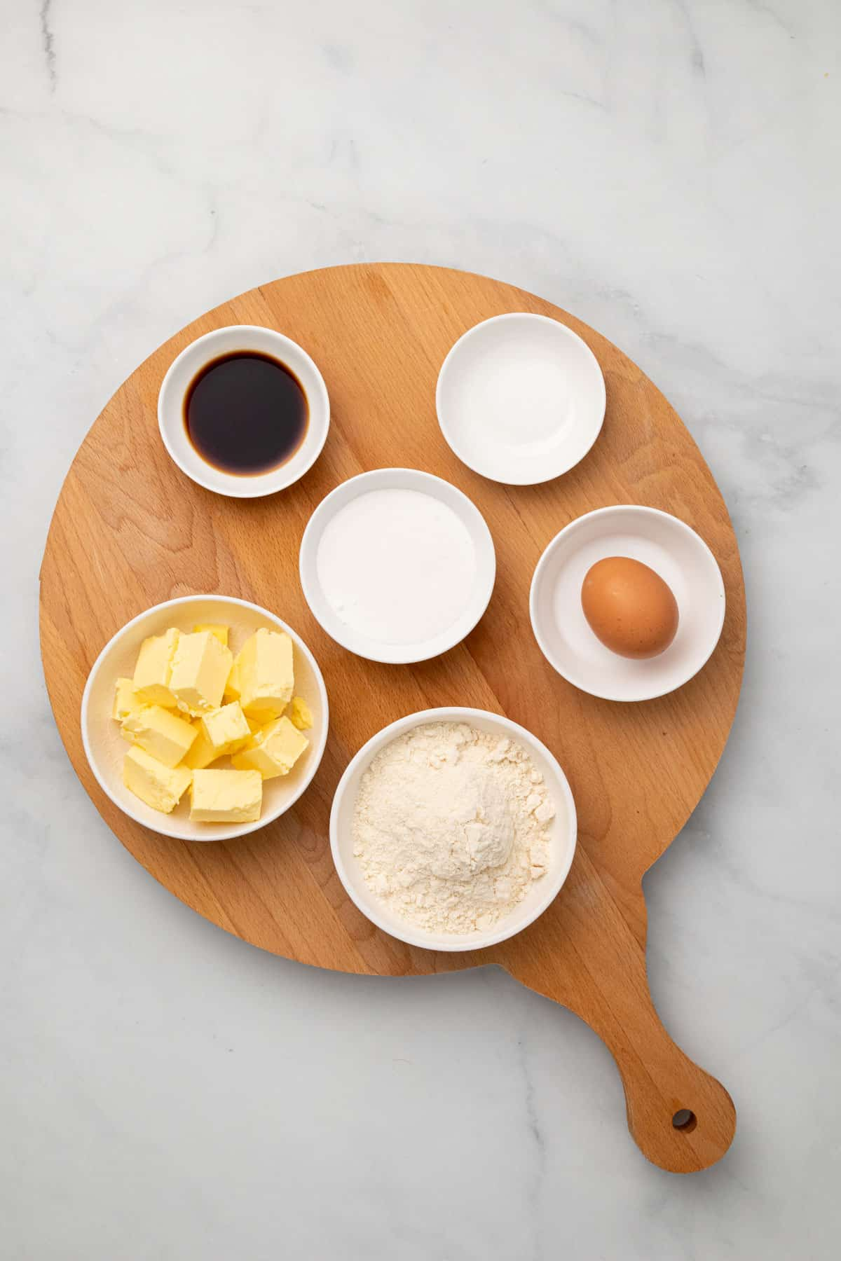 Ingredients for the lemon bars on wooden board