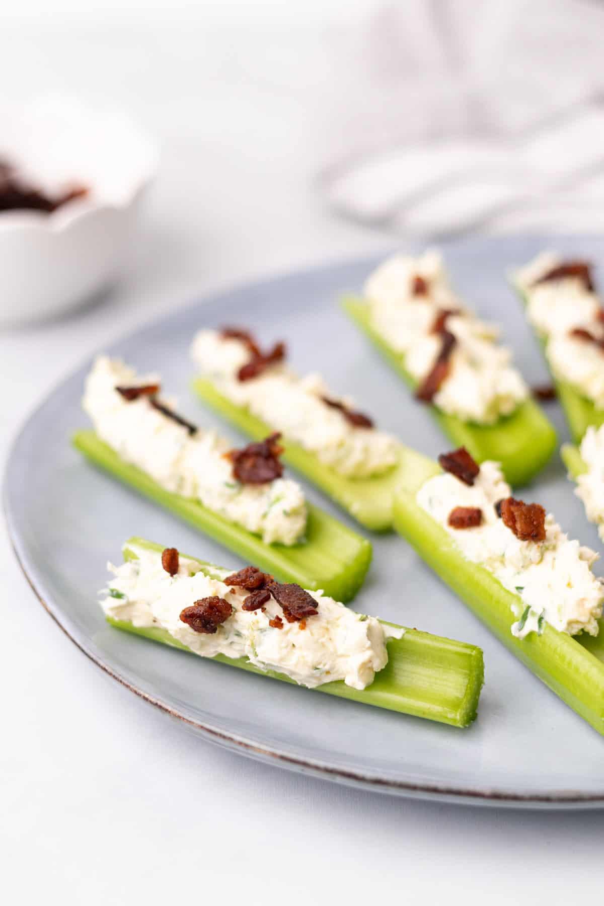 6 stuffed celery stalks on a plate