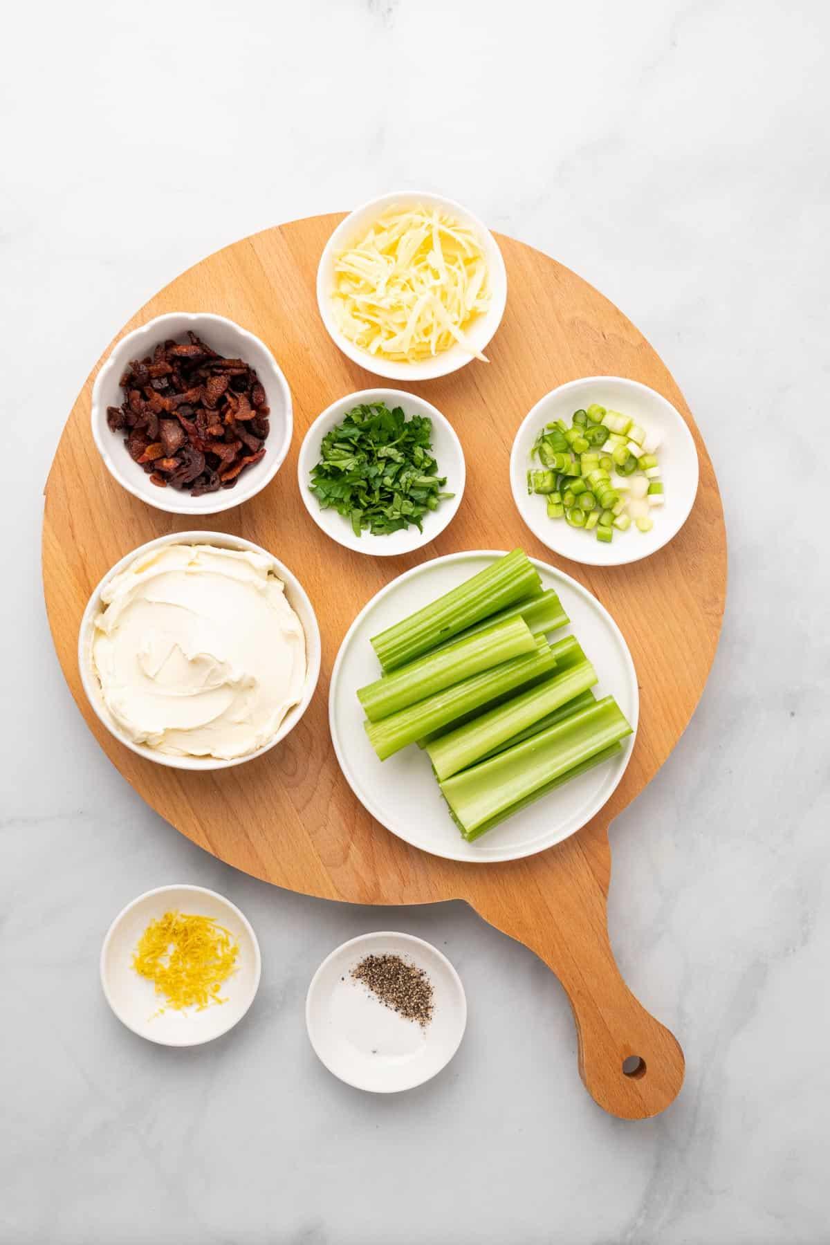 ingredients for stuffed celery on a wooden board