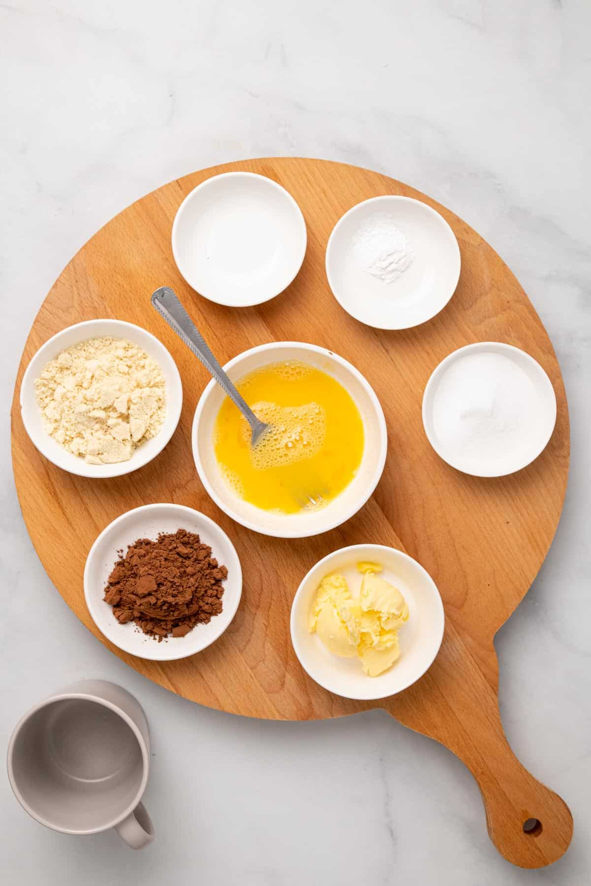ingredients for the cake on a wooden board