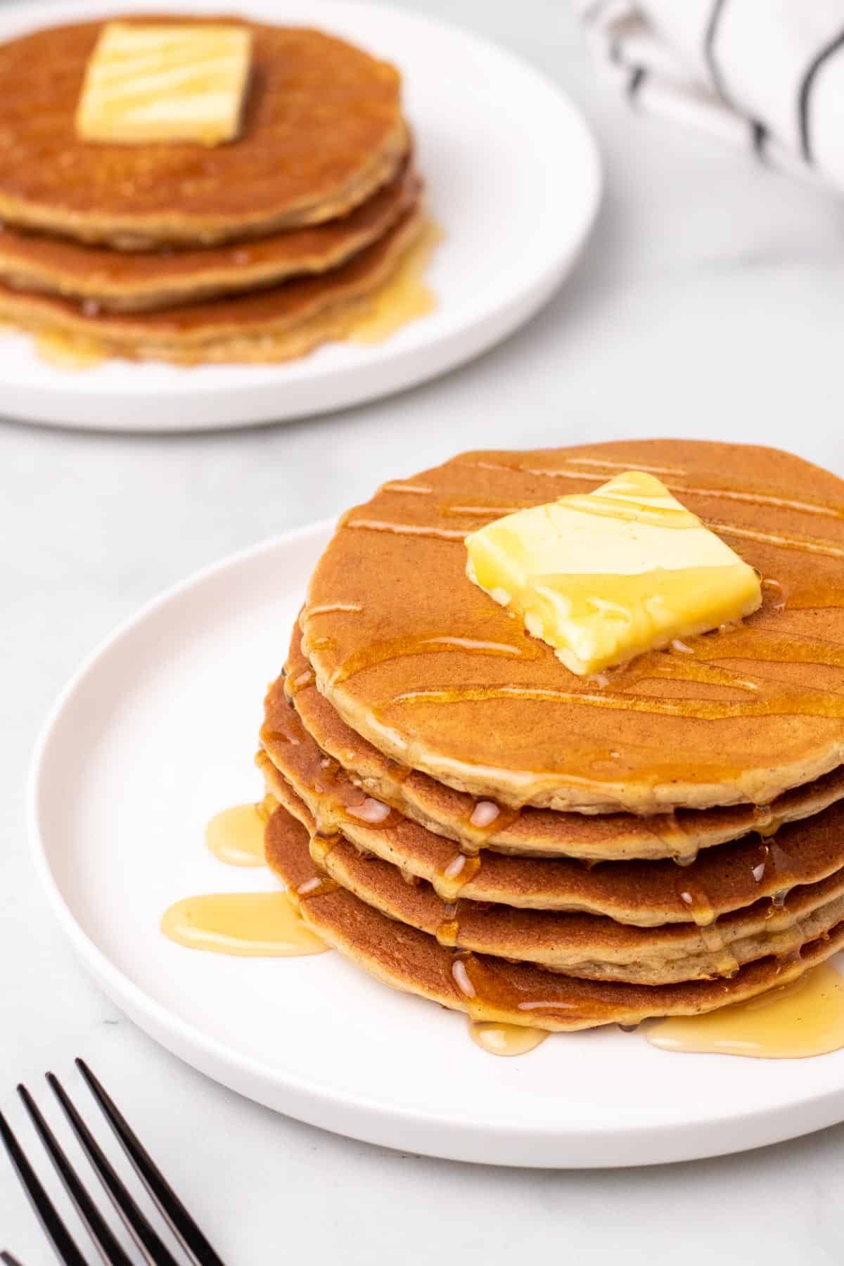 pancakes served with syrup and butter
