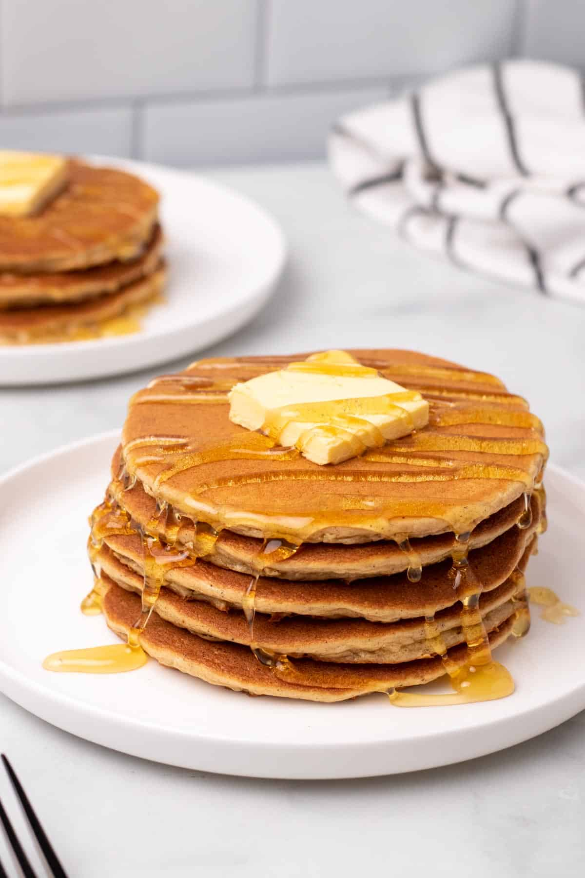 Stack of keto pancakes with butter and sugar-free syrup