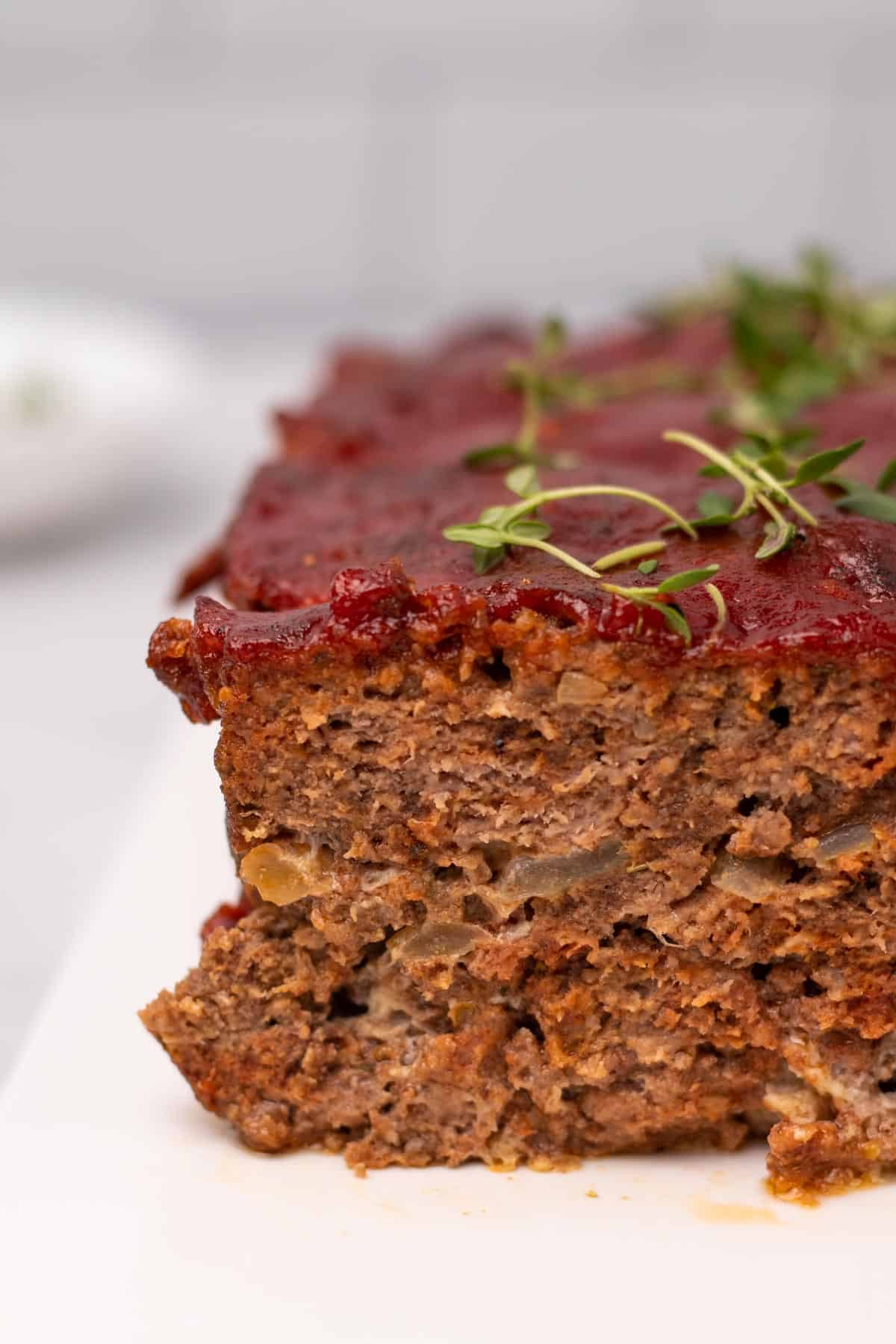 Close-up of meatloaf, garnished with fresh thyme